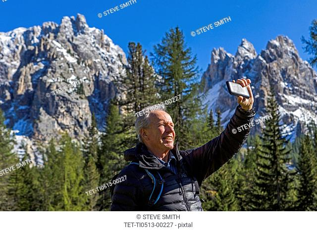 Man taking selfie at Tre Cime di Lavaredo, Italy