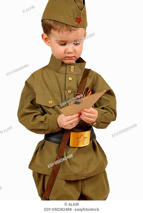 The little boy in the old-fashioned Soviet military uniform with letters from the second world war isolated on white background