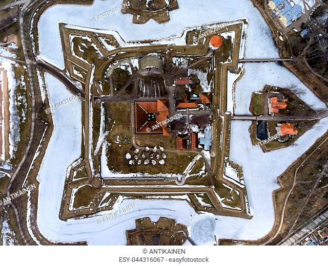 Top view at Kuressaare Castle with icy moat and surrounds at spring season. Saaremaa island, Estonia, Europe