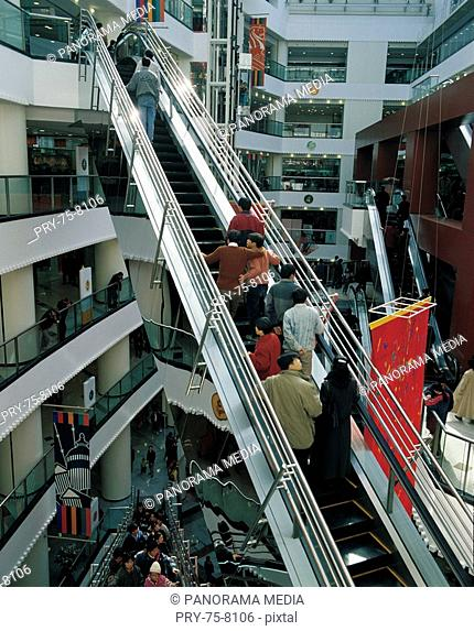 People standing on the elevator of shopping mall