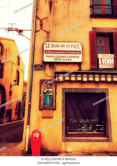 General store, property for sale sign and shrine on wall, Riom, Puy-de-Dome, France, Europe