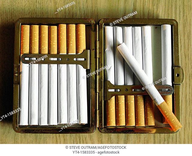 Cigarettes in a metal case