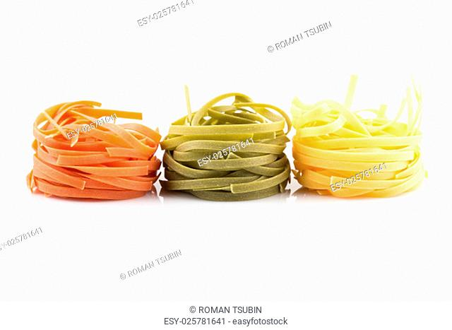 three colour roll nest pasta on a white background