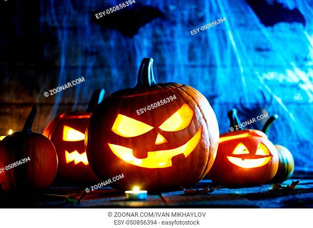 Jack O Lantern Halloween pumpkins, spiders on web, bats and burning candles