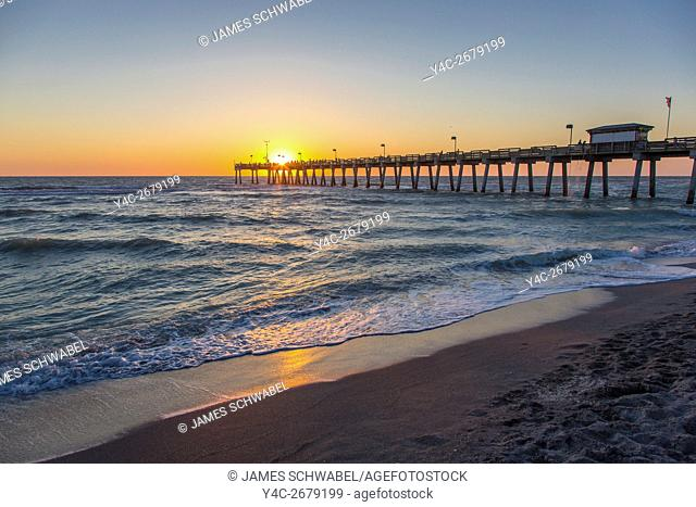 Sunset over Gulf of Mexico at Venice Pier in Venice Florida
