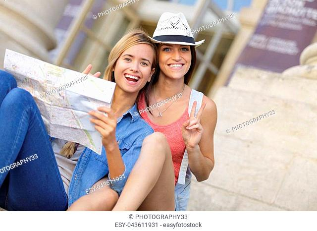young beautiful woman travelers exploring the city