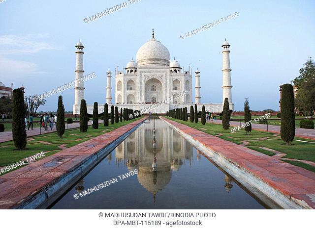 Reflection of Taj Mahal in pond Seventh Wonders of World on the south bank of Yamuna river , Agra , Uttar Pradesh , India UNESCO World Heritage Site