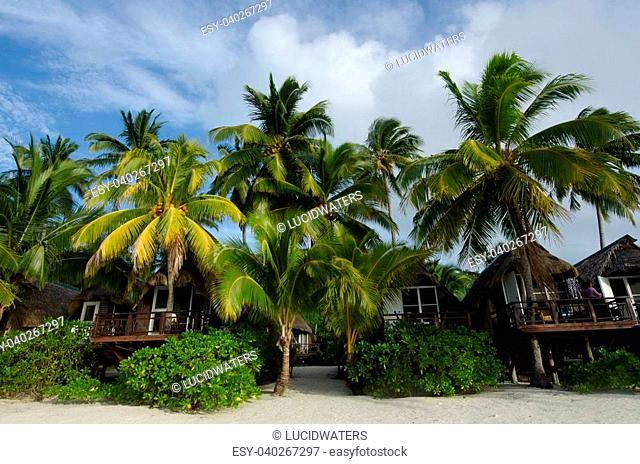 Beach bungalows on Polynesian tropical pacific ocean Island.Photo by Rafael Ben-Ari/Chameleons Eye