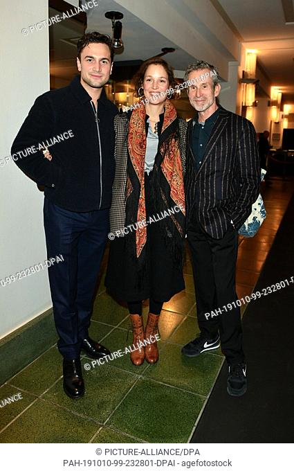 """09 October 2019, Berlin: Samuel Schneider (l-r), his girlfriend Vicky Krieps and Ulrich Matthes come to the premiere of """"""""Faith in the Possibility of the..."""