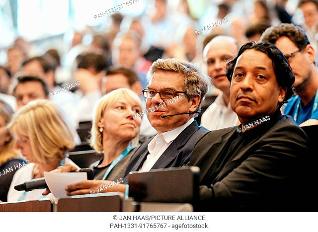 BAYREUTH/GERMANY - JUNE 21: Stefan Winners (Hubert Burda Media, m.) and Cherno Jobatey (Huffington Post) sit in the audience listening to the speaker during the...