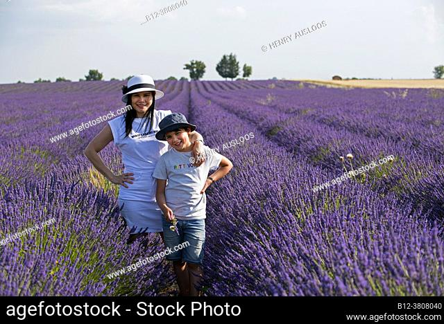 Woman and boy in lavender fields with hat, southern France