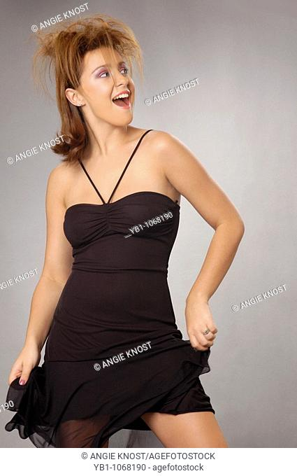 Fashion image of attractive woman in little black dress