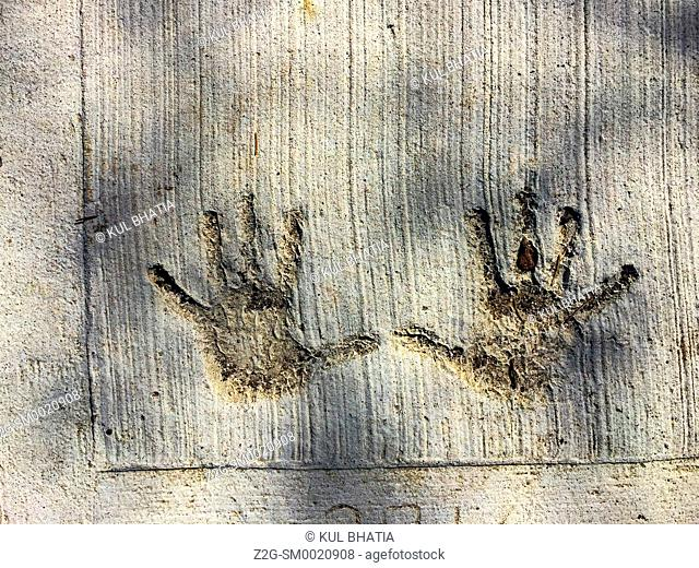 Palm prints in concrete. A freshly laid sidewalk is marred by an unknown pair of hands, Ontario, Canada