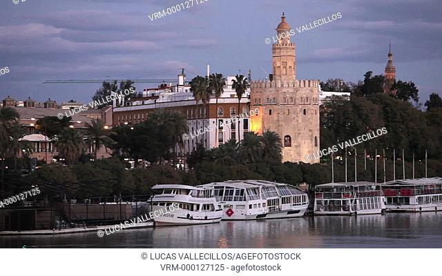 Guadalquivir river, Gold tower, In the background towers of España square. Seville, Andalusia, Spain