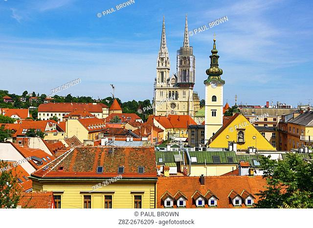 General city skyline view of Zagreb Cathedral with tower renovation and the tower of St. Mary's Church in Zagreb, Croatia