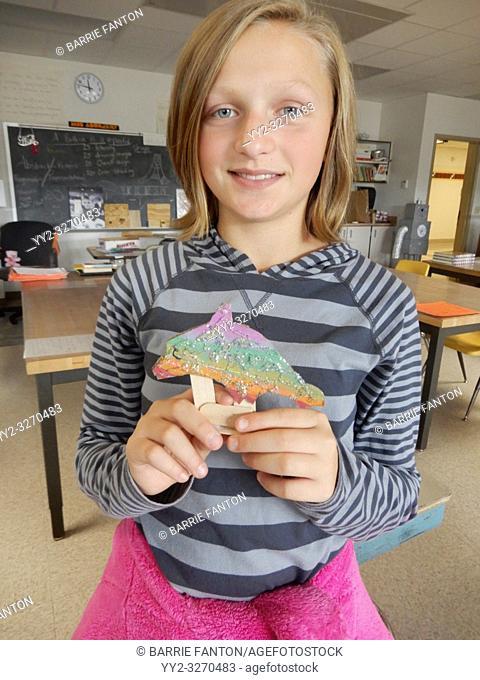 6th Grade Girl Produdly Holding Art Project, Wellsville, New York, USA