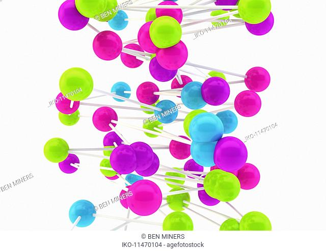 Close up of connected multicolored balls on white background