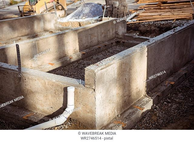 Concrete foundation and drainage pipe