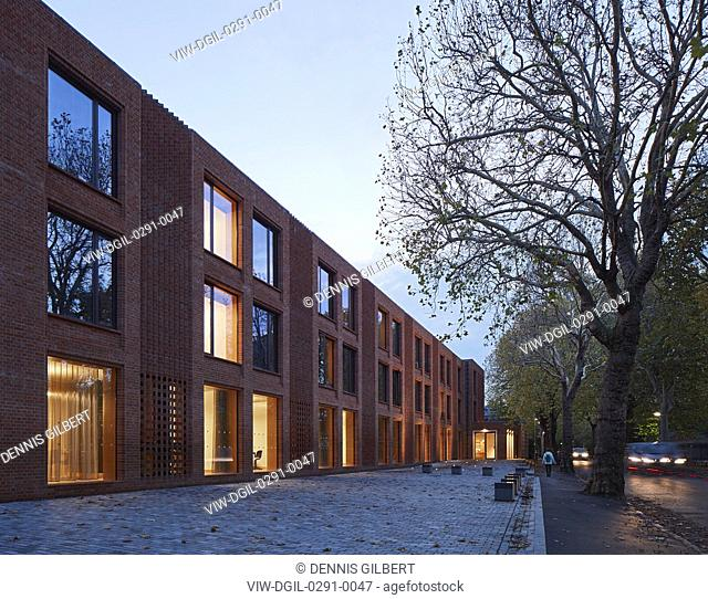 Approach to building with street at dusk. Newnham College, Cambridge, Cambridge, United Kingdom. Architect: Walters and Cohen Ltd, 2018
