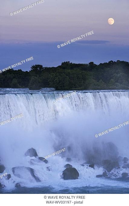 The American Falls at dusk with full moon - Niagara Falls -New York USA