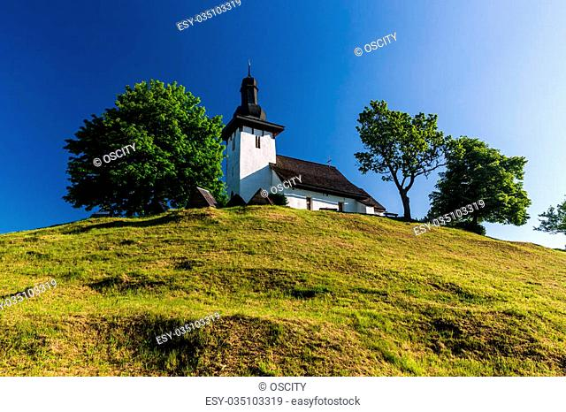 View of a typical old slovak church in the village Martincek near Ruzomberok, Slovakia in summer 2015