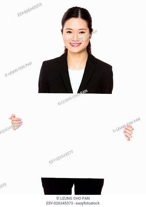 Young businesswoman showing with with banner