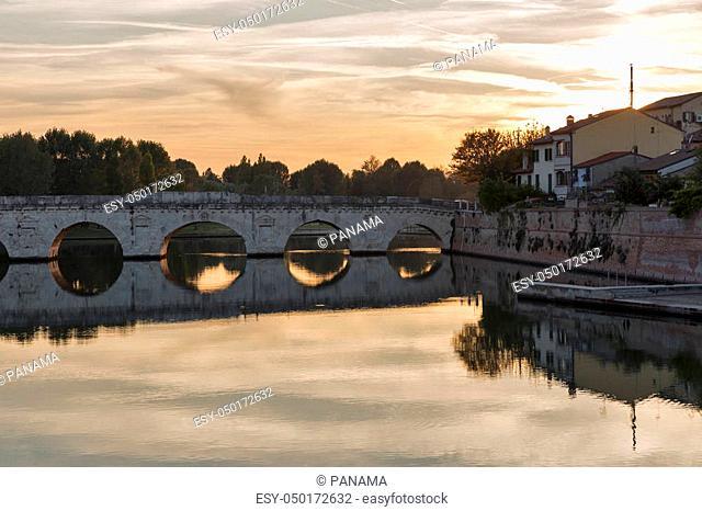 Bridge of Tiberius in Rimini at sunset, Italy