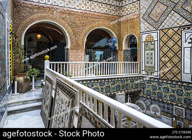 The stunning interior of a retail shop selling traditional arts and crafts. Walls are decorated with gorgeous tiles. Sidi Bou Said, Tunisia, Africa