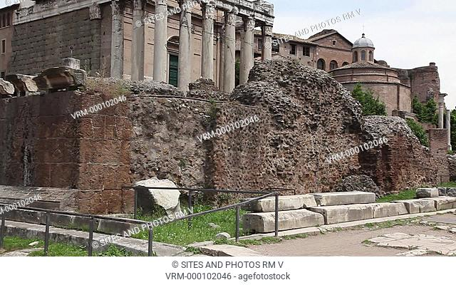 PAN, Daylight. Exterior: The Temple of Divus Julius was built by Augustus in 29 BC, probably on the site where the body of Julius Caesar had been cremated