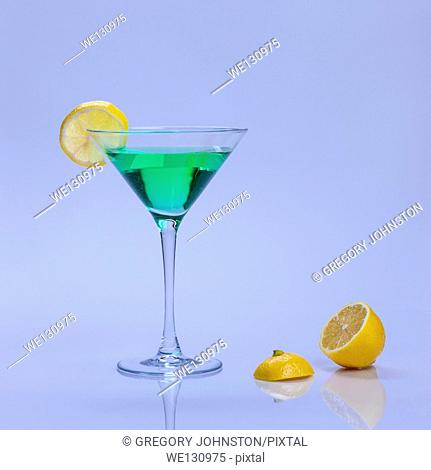 A green drink with a lemon garnish