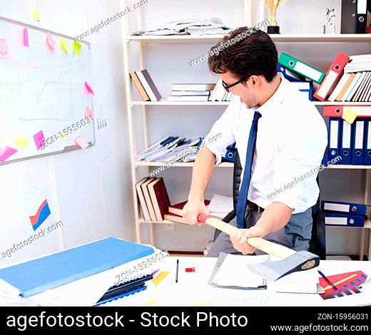 The busy frustrated businessman angry in the office