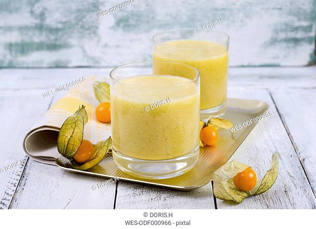 Glasses of physalis smoothie on metal tray