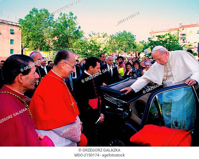 Pope John Paul II (Karol Jozef Wojtyla) getting the parish of Santa Maria Assunta at Tufello. Rome, Italy, 1990s