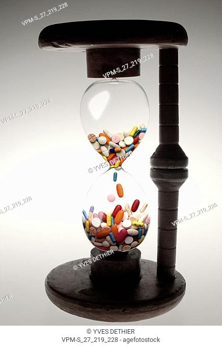 Close-up of pills in an hourglass