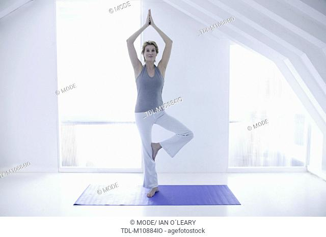 A woman in her forties doing yoga