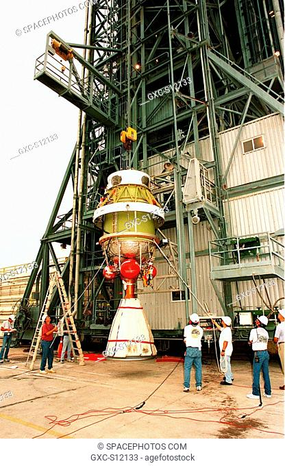 11/03/1998 --- Workers at pad 17A at Cape Canaveral Air Station begin lifting the second stage of a Delta II rocket up the gantry