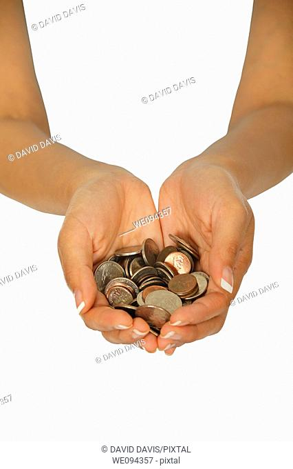 Female holding a hand full of US coins