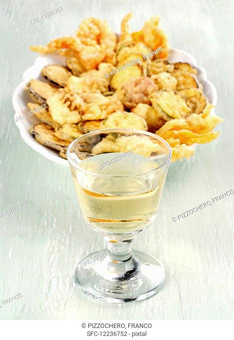 Fritto misto with vegetables and a glass of white wine