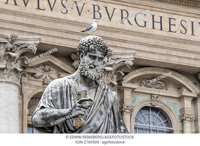 Rome, Italy- Close up of a seagull resting on a Roman sculpture on the exterior of (New) St. Peter's Basilica located in Vatican City (an enclave of Rome)