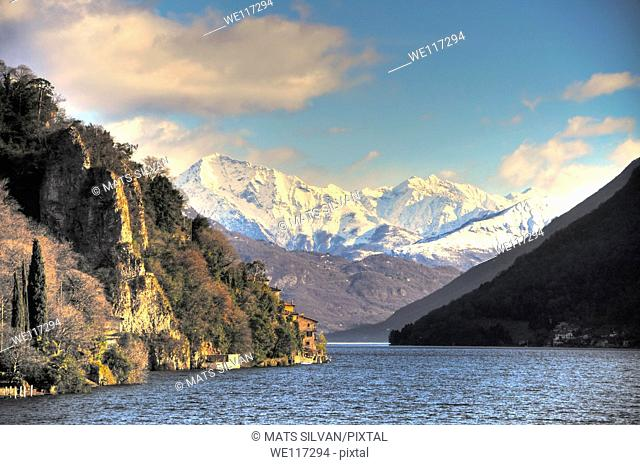 Lake with snow-capped mountain and blue sky and clouds