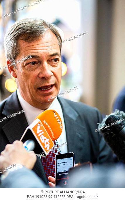 23 October 2019, France (France), Straßburg: Nigel Farage, Chairman of the British Brexit Party, speaks into microphones in the European Parliament building
