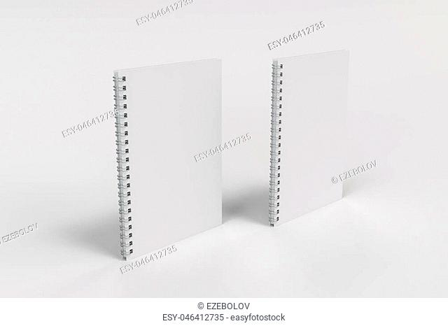Two blank notebooks with white cover and metal spiral bound on white background. Business or education mockup. 3D rendering illustration