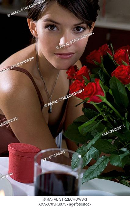 woman sitting next to table during romantic dinner