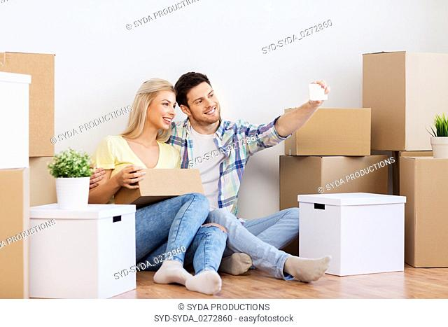 couple taking selfie and moving to new home