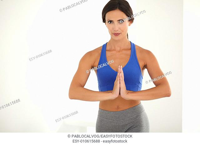 Pretty young lady in sport clothing doing sports training for wellbeing - copyspace