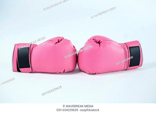 Close-up pair of pink boxing gloves