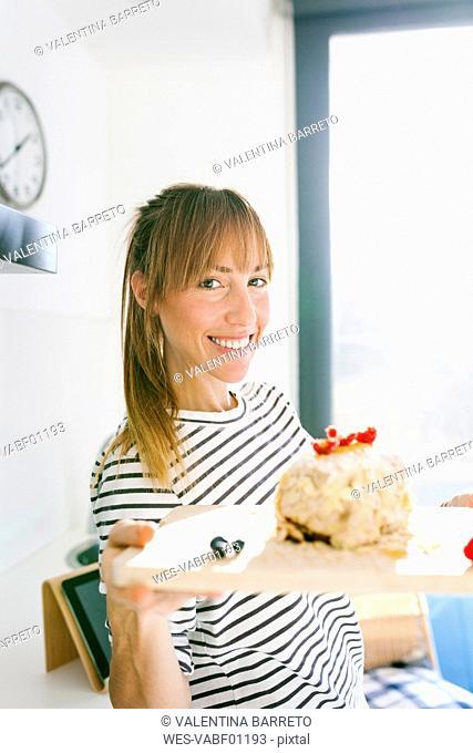 Young woman presenting vegan cake