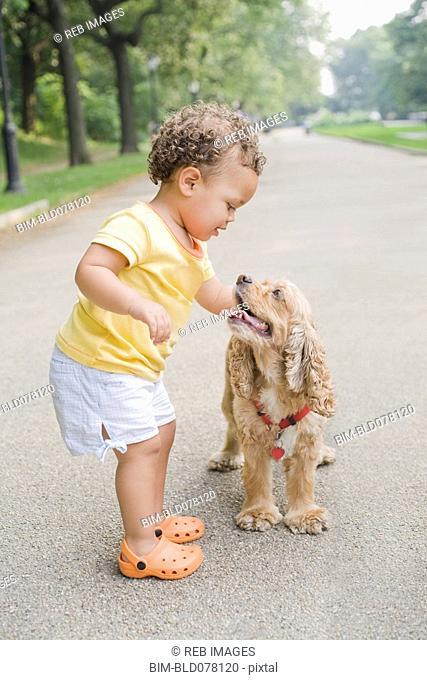 Hispanic girl petting dog