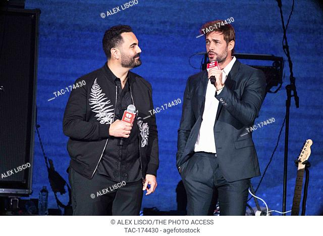 Enrique Santos and William Levy on stage at the iHeartRadio Fiesta Latina 2019 at the AmericanAirlines Arena in Miami, Florida on November 2 2019