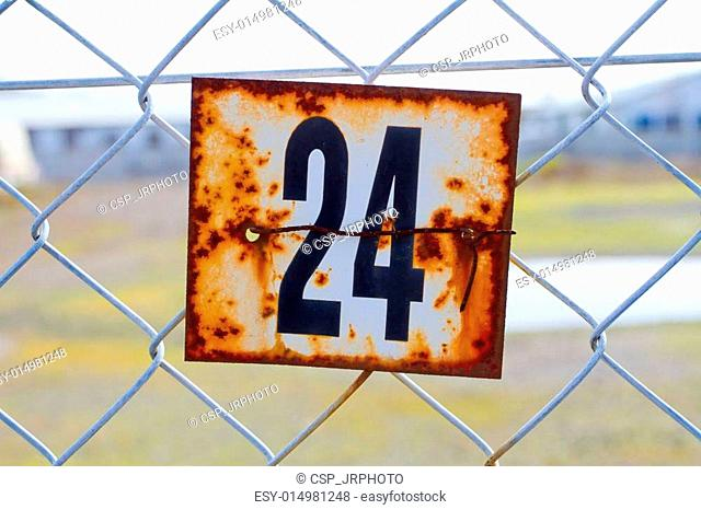 Number 24 Rusted Sign